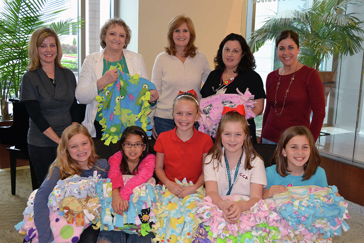 Members of the Sugar Land First United Methodist Church who donated the baby blankets.
