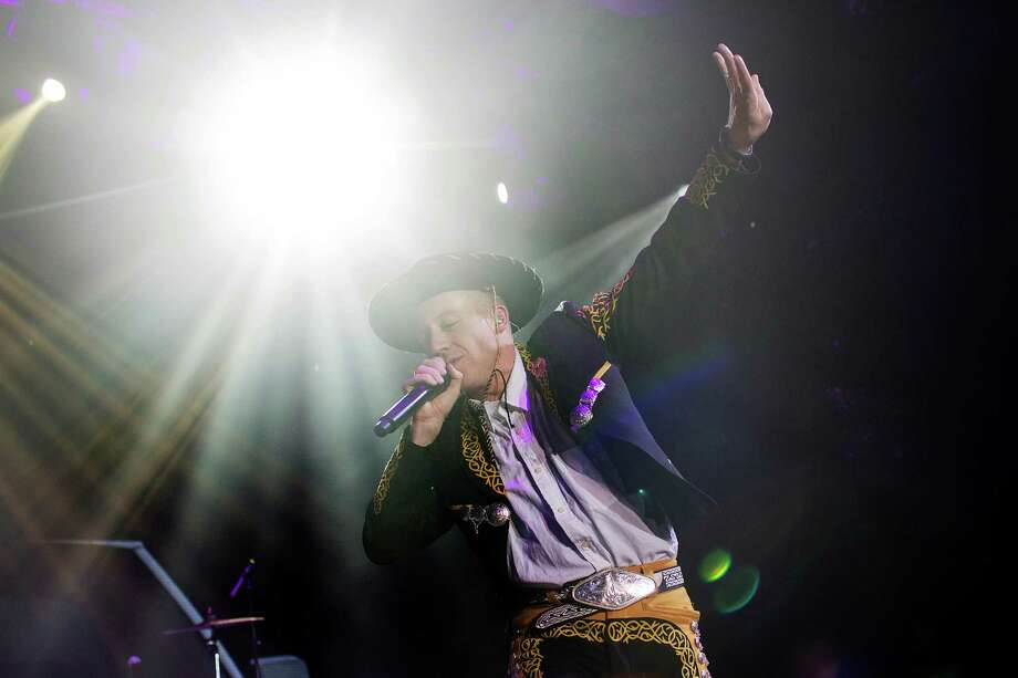 Rapper Macklemore performs during the Microsoft Corp. midnight launch event in New York, U.S., on Friday, Nov. 22, 2013. The Xbox One console incorporates software and systems developed throughout the rest of Microsoft and is the first big test of what the company calls its One Microsoft strategy. Photographer: Victor J. Blue/Bloomberg *** Local Caption *** Macklemore Photo: Victor J. Blue, Courtesy / © 2013 Bloomberg Finance LP