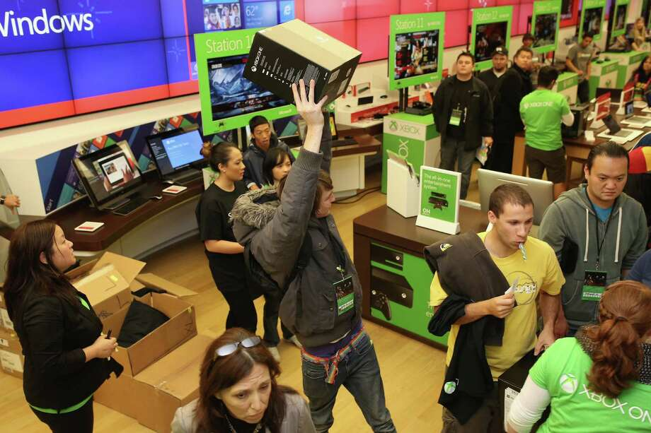 SAN DIEGO, CA - NOVEMBER 22:  An excited fan shows off his new Xbox One after purchasing it at midnight from the Microsoft retail store in Fashion Valley Mall in San Diego, California on Nov. 22, 2013.  (Photo by Robert Benson/Getty Images for Microsoft) Photo: Robert Benson, Courtesy / 2013 Getty Images