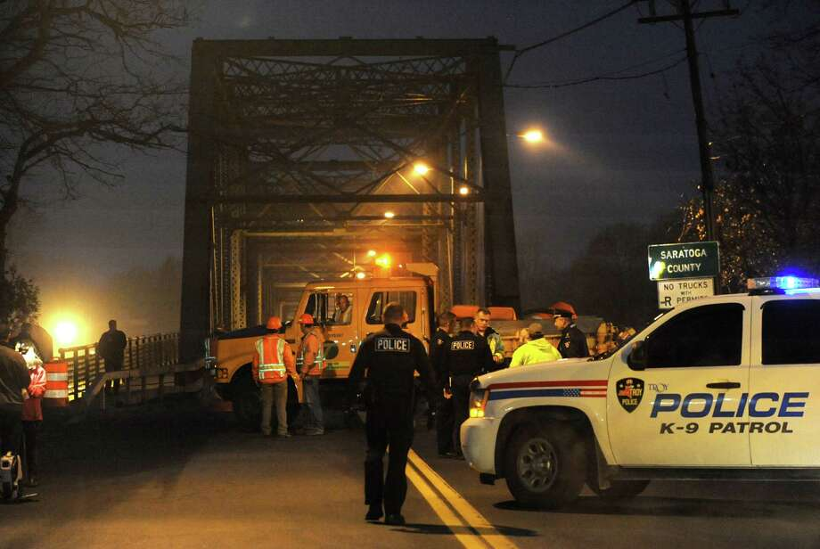 Officials block off the Troy-Waterford 126th St. bridge that brings Rt. 4 from Troy to Waterford on Friday, Nov. 22, 2013 in Troy, N.Y. Cracks were found in the structure and the bridge was closed to traffic and pedestrians immediately about 4pm for safety reasons. (Lori Van Buren / Times Union) Photo: Lori Van Buren / 00024779A