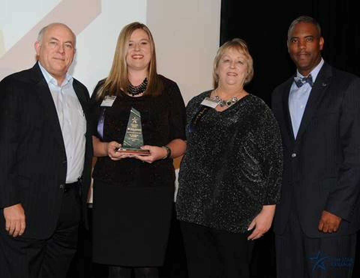From left, Richard Carpenter, Kim Bellini, Beth Buzbee and Austin Lane celebrate The Woodlands Learning Rx winning the Small Business of the Year Award, Lone Star College Montgomery.