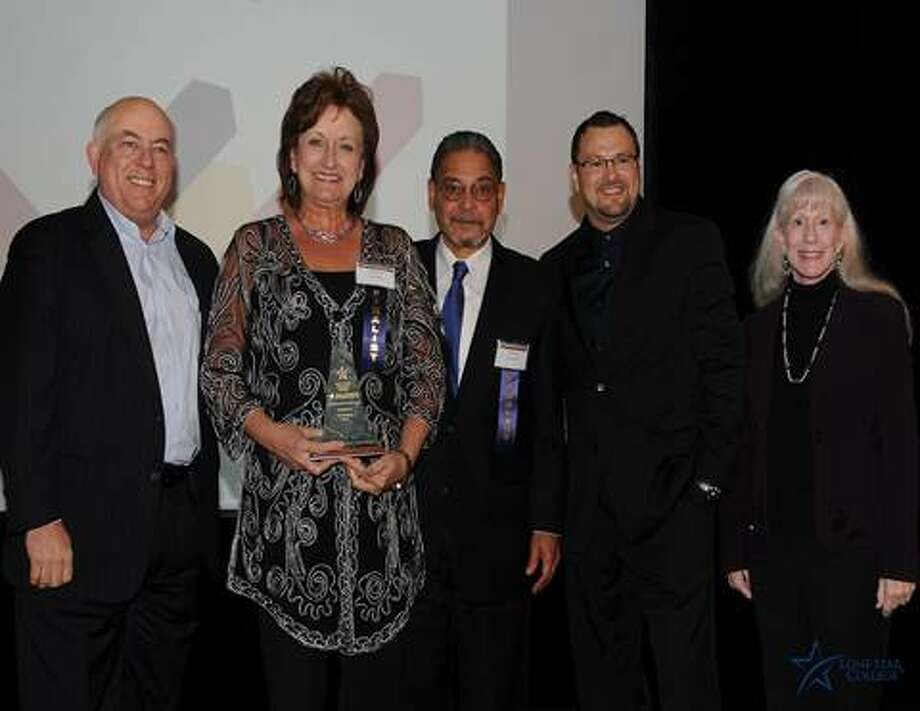 From left, Richard Carpenter, Alice Arevale, David Arevalo, Mark McCann and Susan Karr celebrate Country Air winning the Small Business of the Year Award, Lone Star College Tomball. Photo: Provided By Lone Star College System Small Business Development Center Advisory Council
