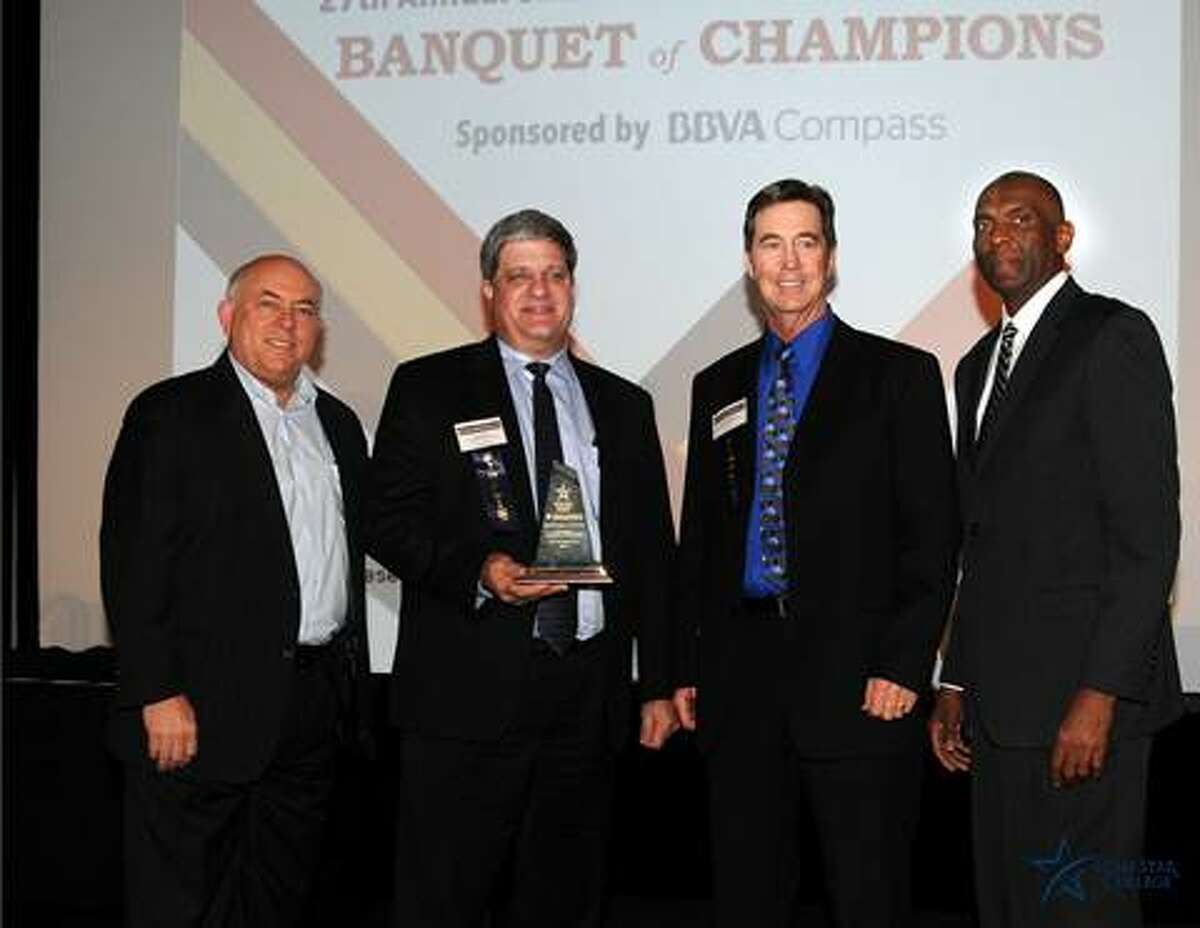 From left, Richard Carpenter, Jerry Hays, David Vaughan and Lawrence Brandyburg celebrate Kwik Copy Business Center No. 117 winning the Small Business of the Year Award, Lone Star College University Park.