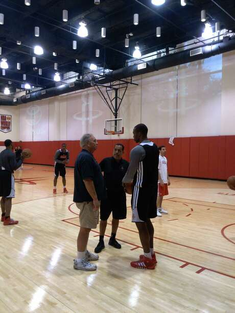 Dwight Howard, right, soaks in some of the low-post wisdom Carroll Dawson, left, employed to accelerate Hakeem Olajuwon's rise into the elite of NBA big men. Photo: Jonathan Feigen