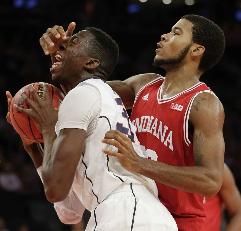 Connecticut's Amida Brimah, left, and Indiana's Jeremy Hollowell fight for a rebound during the first half of an NCAA college basketball game on Friday, Nov. 22, 2013, in New York. (AP Photo/Seth Wenig) Photo: Seth Wenig, ASSOCIATED PRESS / AP2013