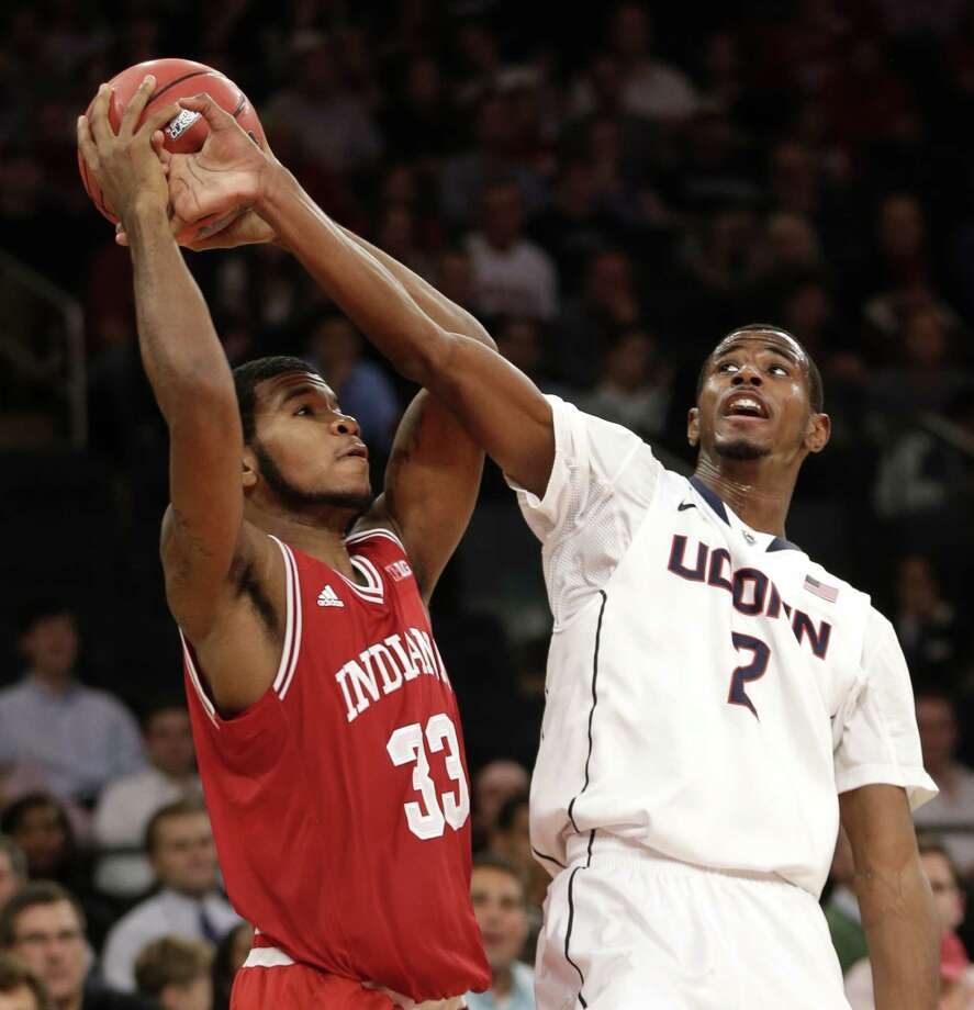 Indiana's Jeremy Hollowell, left, fights for a rebound with Connecticut's DeAndre Daniels during the first half of an NCAA college basketball game on Friday, Nov. 22, 2013, in New York. Photo: Seth Wenig, AP / Associated Press