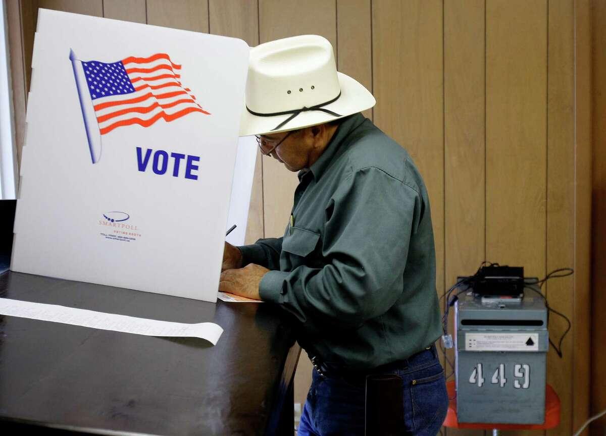 A voter fills out his ballot at the Callaghan Ranch, a rural area polling site, near Laredo, Texas, Tuesday, Nov. 4, 2008.