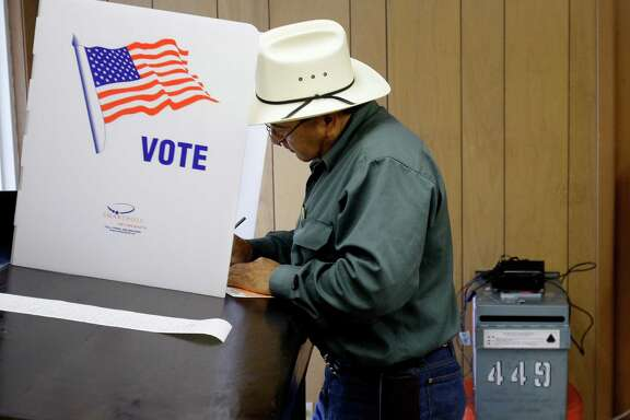 A voter fills out his ballot at the Callaghan Ranch, a rural area polling site, near Laredo, Texas, Tuesday, Nov. 4, 2008. Many obstacles exist for Texas to turn blue, not the least of which is the loss of white voters from the Democratic Party. (AP Photo/Eric Gay)