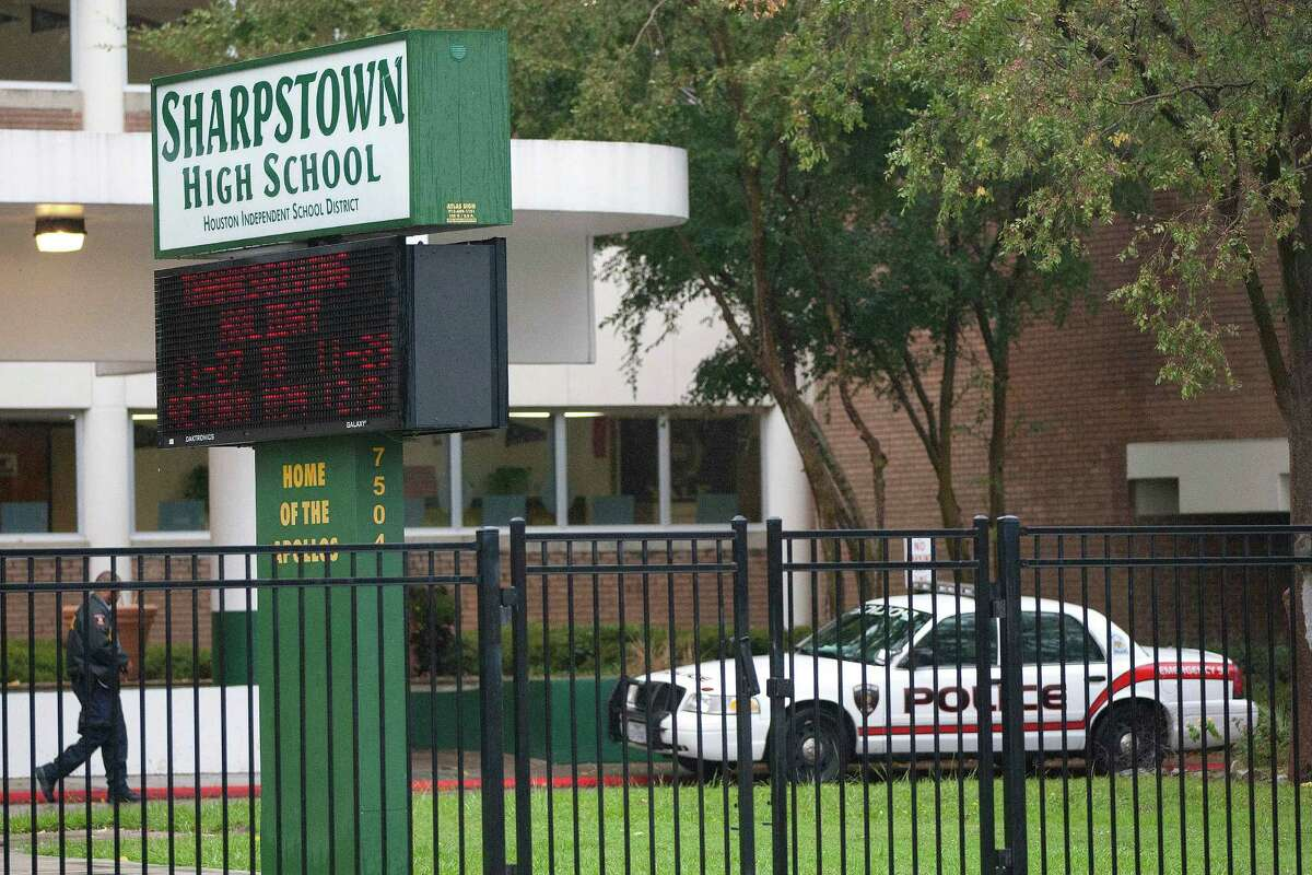 Sharpstown High School still had a police presence Friday, a day after its principal and two assistant principals were arrested.