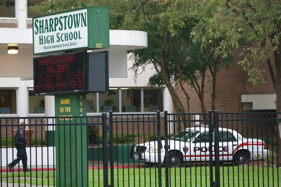 Sharpstown High School still had a police presence Friday, a day after its principal and two assistant principals were arrested. Photo: Johnny Hanson, Staff / Houston Chronicle