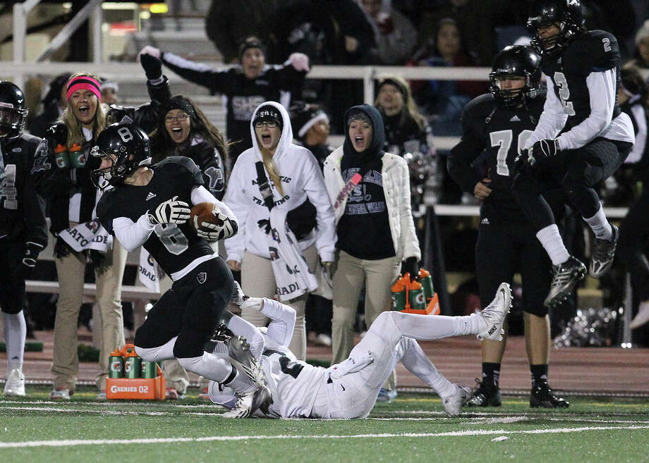 The Steele sideline reacts as Mark Frankhouser (08) gets tackled after intercepting a pass against Reagan's Connor Hefron (02) during their 5A playoff game at Comalander Stadium on Friday, Nov. 22, 2013. Photo: Kin Man Hui, San Antonio Express-News / ©2013 San Antonio Express-News