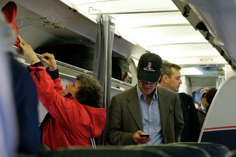 Both Southwest and United Airlines said customers have spoken out against the idea of in-flight calls. The FCC will discuss the proposal at its Dec. 12 meeting. Photo: Matt Slocum, STF / AP