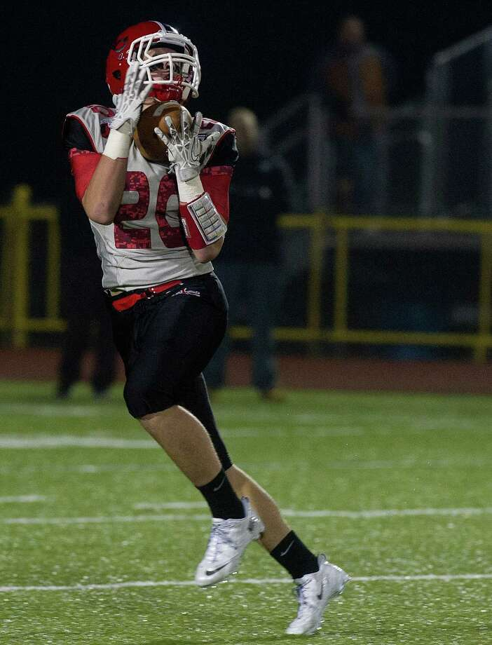 New Canaan's Kyle Smith makes a catch and runs for a touchdown during Friday's FCIAC championship game at Trumbull High School on November 22, 2013. Photo: Lindsay Perry / Stamford Advocate