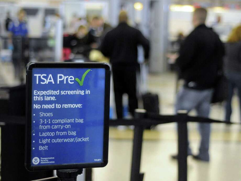 The TSA PreCheck program allows eligible travelers to skip long lines and avoid some tasks like taking off shoes for inspection. Photo: Dave Rossman, Freelance / © 2013 Dave Rossman