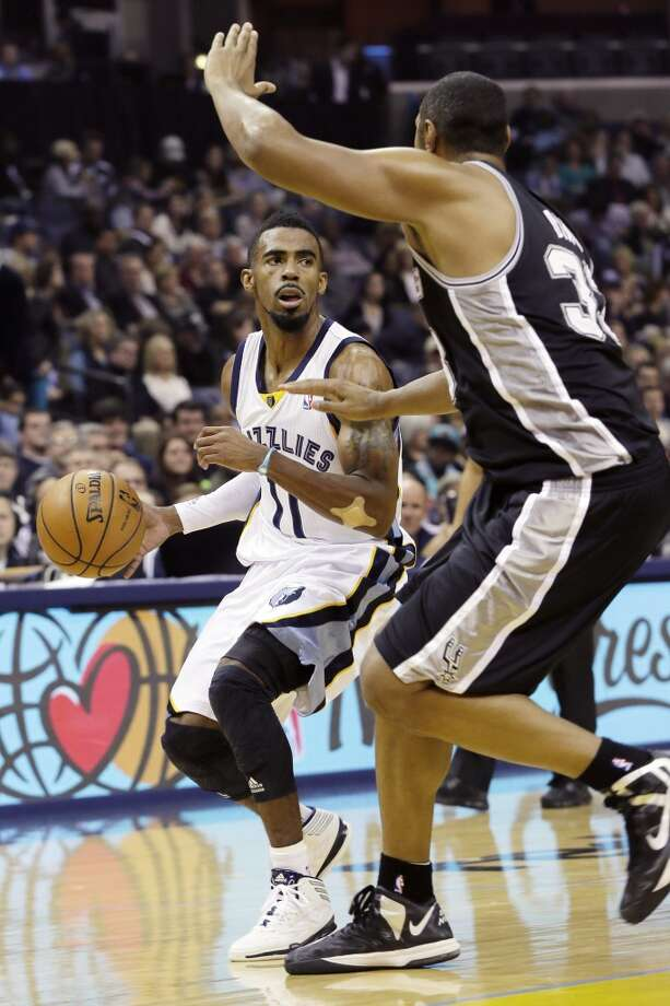 Memphis Grizzlies' Mike Conley (11) dribbles the ball past San Antonio Spurs' Boris Diaw, of France, in the first half of an NBA basketball game in Memphis, Tenn., Friday, Nov. 22, 2013. (AP Photo/Danny Johnston) Photo: Associated Press