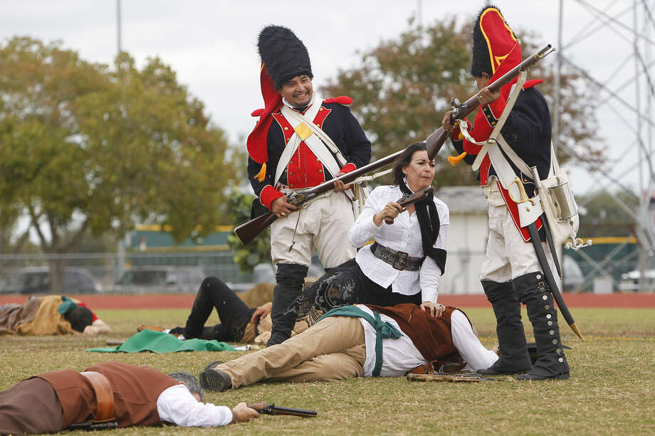 A woman sympathetic to the Republican Army of the North lashes out against Spanish Army soldiers as they mock her during the reenactment of the Battle of Medina on Nov. 16.