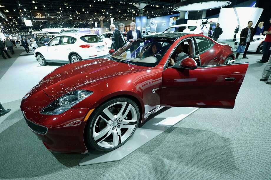 A Fisker Karma is displayed at the Los Angeles Auto show in November 2012. Hybrid Technology is the California automaker's new owner. Photo: Kevork Djansezian, Staff / 2012 Getty Images