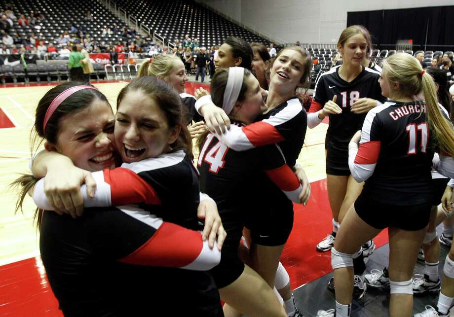 Churchill's Katie Pope (left) hugs Nina Sansavera as they celebrate after beating Southlake Carroll in the Class 5A state semifinals on Nov. 22 in Garland. Photo: Mike Stone, For The San Antonio Express-News / 00019962A