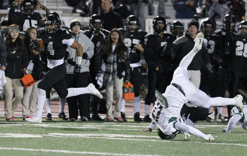 Steele's Justin Stockton (04) breaks away in the first possession of the game to score a touchdown against Reagan during their 5A playoff game at Comalander Stadium on Friday, Nov. 22, 2013.