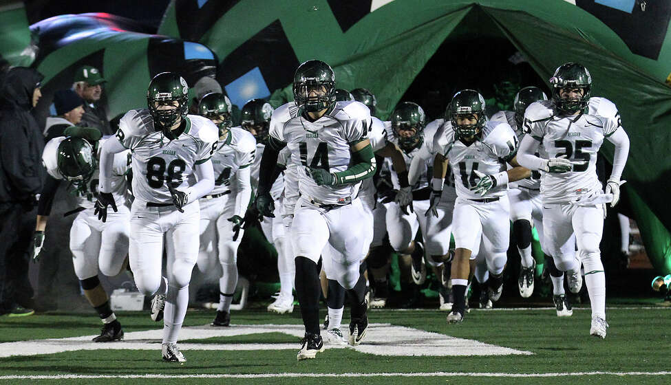 The Reagan Rattlers take the field for their playoff game against Steele at Comalander Stadium on Friday, Nov. 22, 2013.