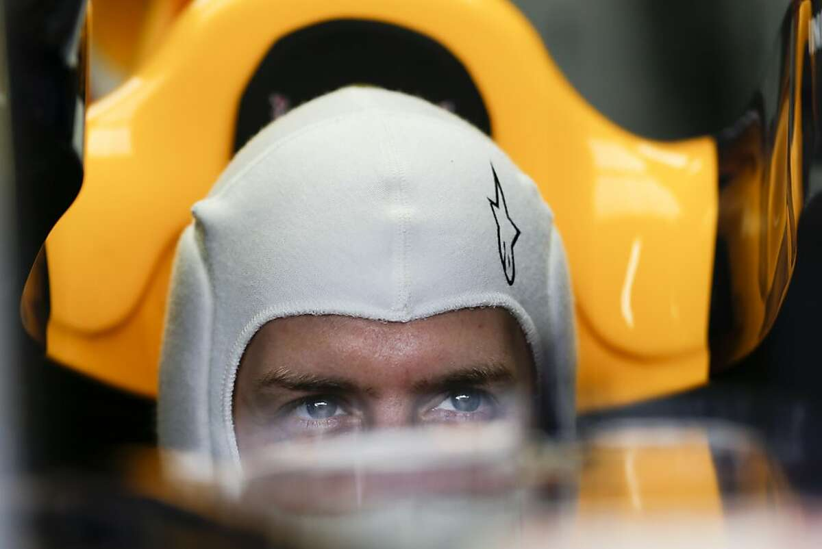 Red Bull driver Sebastian Vettel from Germany sits inside his car during a free practice at the Interlagos race track in Sao Paulo, Brazil, Friday, Nov. 22, 2013. The Brazilian Formula One Grand Prix will take place on Sunday. (AP Photo/Felipe Dana)