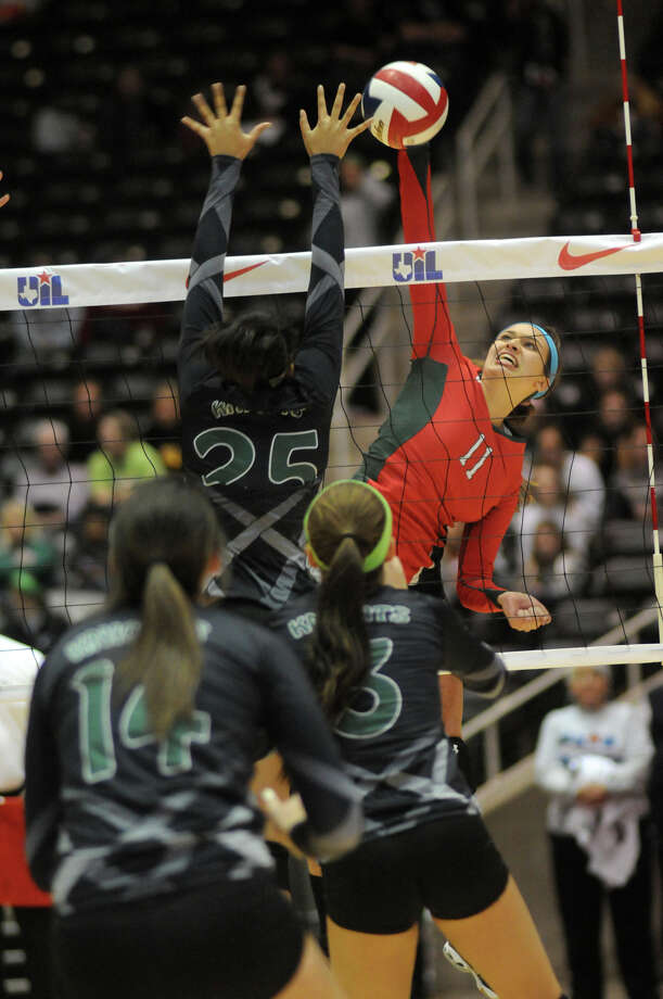 The Woodlands junior outside hitter Courtney Quinn, right, takes her best shot against a host of Clear Falls defenders during the Class 5A semifinals matchup Friday night. Quinn wound up with a team-high 18 kills. Photo: Jerry Baker, Freelance