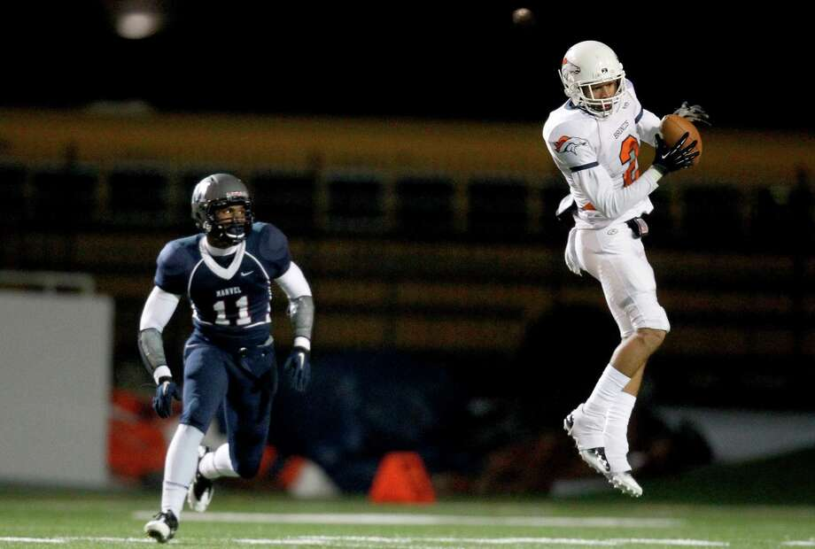 11/22/13 : George Bush Bronco Donald Moore (2) catches the pass while   Manvel Maverick Collin Scott (11) defends on the play in a high school play-off game at Veterans Memorial Stadium in Pasadena, TX. Photo: Thomas B. Shea, For The Chronicle / © 2013 Thomas B. Shea