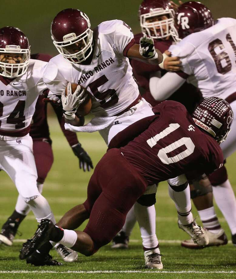 Cy Fair 24, Cinco Ranch 14Cinco Ranch's Denzell Bates (5) is tackled for a loss by Cy-Fair's Brandon Richmond (10) during the first half of a high school football playoff game, Friday, November 22, 2013, at Pridgeon Stadium in Houston. Photo: Eric Christian Smith, For The Chronicle