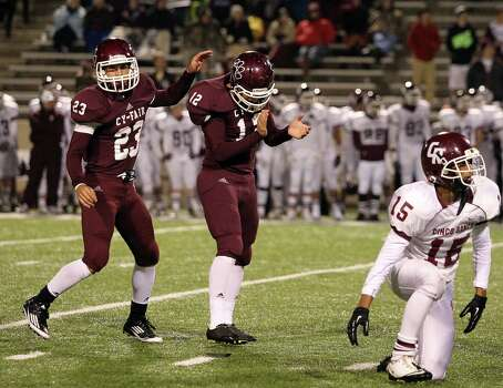 Cy-Fair's Braden Mann (12) celebrates his 38-yard field goal with teammate Preston Wallace as Cinco Ranch's Corey Rau (15) looks on during the second half of a high school football playoff game, Friday, November 22, 2013, at Pridgeon Stadium in Houston. Photo: Eric Christian Smith, For The Chronicle