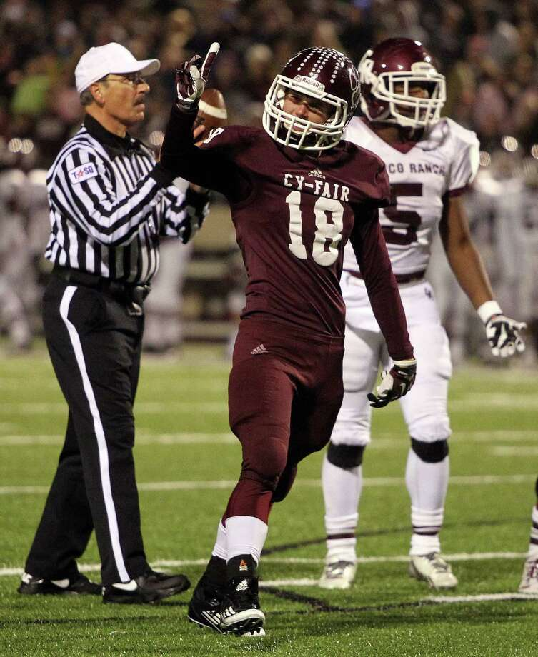 Cy-Fair's Mazz Chrest (18) celebrates the Bobcats' tackle for a loss of Cinco Ranch's Denzell Bates (5) during the second half of a high school football playoff game, Friday, November 22, 2013, at Pridgeon Stadium in Houston. Photo: Eric Christian Smith, For The Chronicle