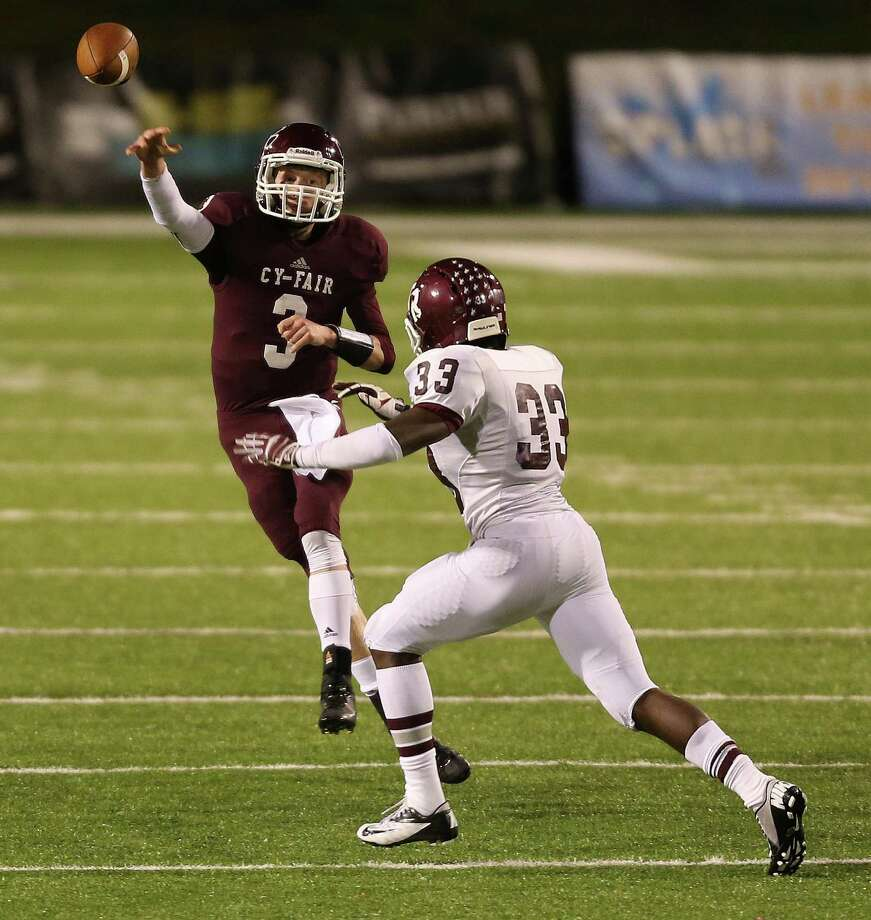 Cy-Fair quarterback Clayton Kopecky (3) throws a pass over Cinco Ranch's Dami Ilesanmi during the second half of a high school football playoff game, Friday, November 22, 2013, at Pridgeon Stadium in Houston. Photo: Eric Christian Smith, For The Chronicle