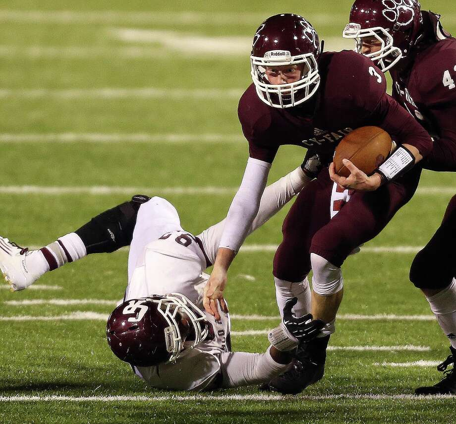 Cy-Fair's Clayton Kopecky (3) avoids the tackle of Cinco Ranch's Ani Ubaha during the second half of a high school football playoff game, Friday, November 22, 2013, at Pridgeon Stadium in Houston. Photo: Eric Christian Smith, For The Chronicle