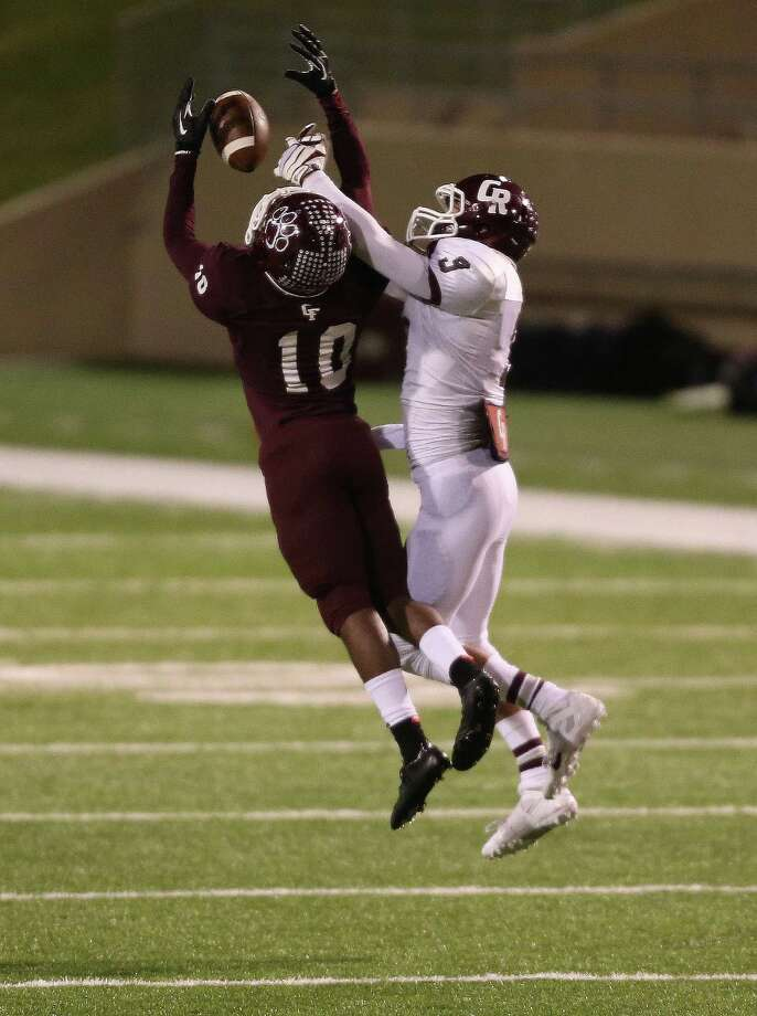 Cy-Fair's Brandon Richmond, left, intercepts a pass intended for Cinco Ranch's Matt Hutson late in the second half of a high school football playoff game, Friday, November 22, 2013, at Pridgeon Stadium in Houston. Photo: Eric Christian Smith, For The Chronicle