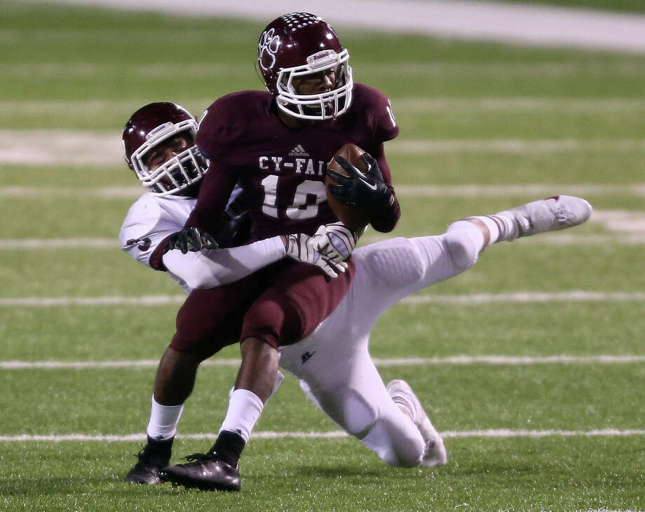 Cy-Fair's Brandon Richmond, right, runs the ball back after intercepting a pass intended for Matt Huston, left, late in the second half of a high school football playoff game, Friday, November 22, 2013, at Pridgeon Stadium in Houston. Photo: Eric Christian Smith, For The Chronicle