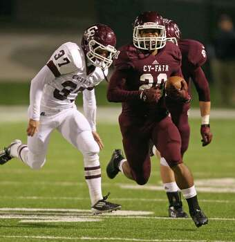 Cy-Fair's Dillon Birden (20) scampers past Cinco Ranch's Ian Johnson (37) for a touchdown during the first half of a high school football playoff game, Friday, November 22, 2013, at Pridgeon Stadium in Houston. Photo: Eric Christian Smith, For The Chronicle