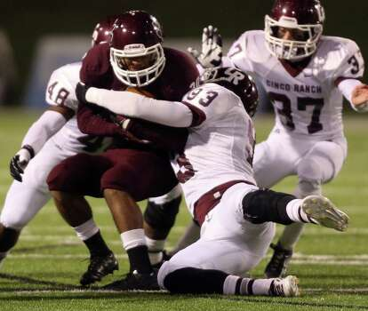 Cy-Fair's Dillon Birden, left, is tackled by Cinco Ranch's Tobi Ilesanmi (93) during the first half of a high school football playoff game, Friday, November 22, 2013, at Pridgeon Stadium in Houston. Photo: Eric Christian Smith, For The Chronicle
