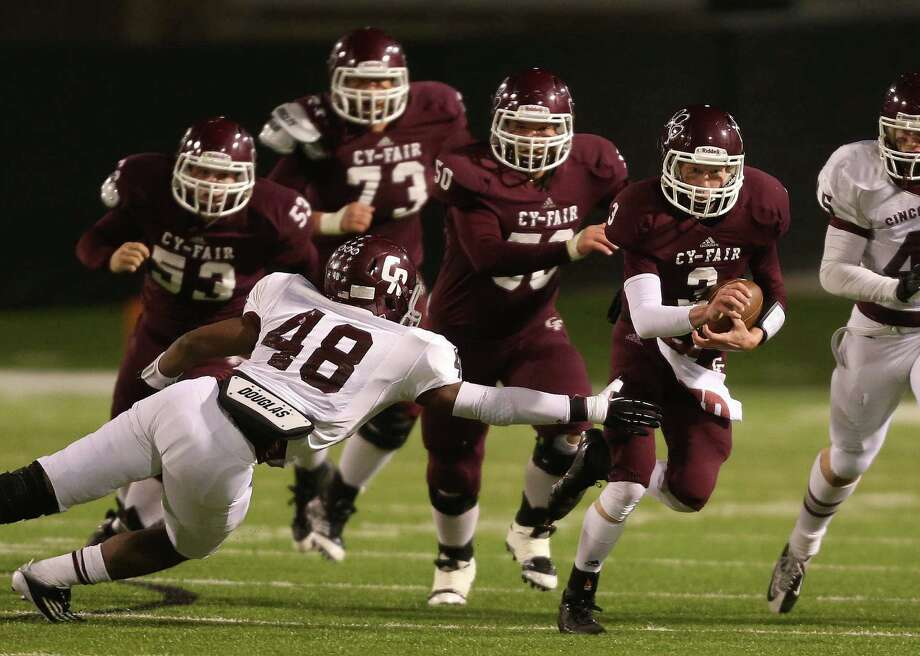 Cy-Fair's Clayton Kopecky (3) scampers past Cinco Ranch's Donovan Roberts (48) during the first half of a high school football playoff game, Friday, November 22, 2013, at Pridgeon Stadium in Houston. Photo: Eric Christian Smith, For The Chronicle