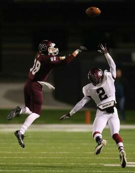 Cy-Fair's Noah Hess, left, can't come up with the reception as Cinco Ranch's Jaylen Hunter defends during the first half of a high school football playoff game, Friday, November 22, 2013, at Pridgeon Stadium in Houston. Photo: Eric Christian Smith, For The Chronicle