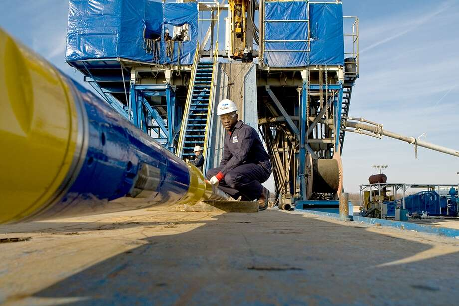 New technologies are cutting the time spent on wells. Baker Hughes promotes its AutoTrak Curve, a steerable drilling system. / Miller Photography Inc.