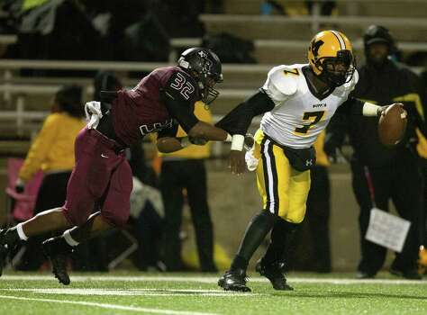Marshall's J.W. Ketchum (7) is sacked by George Ranch's Traveon Wyche (32) in the second quarter during a high school playoff football game between Fort Bend Marshall and George Ranch, Friday, November 22, 2013 in Sugar Land. (Bob Levey/Special To Chronicle) Photo: Bob Levey, Houston Chronicle / ©2013 Bob Levey