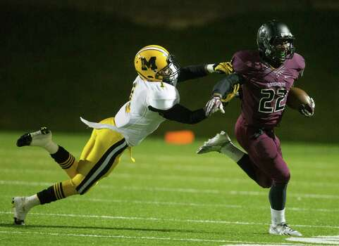 George Ranch running back  Collins Kwabena (22) attempts to break loose from Marshall's Jordan Horace (1)during a high school playoff football game between Fort Bend Marshall and George Ranch, Friday, November 22, 2013 in Sugar Land. (Bob Levey/Special To Chronicle) Photo: Bob Levey, Houston Chronicle / ©2013 Bob Levey