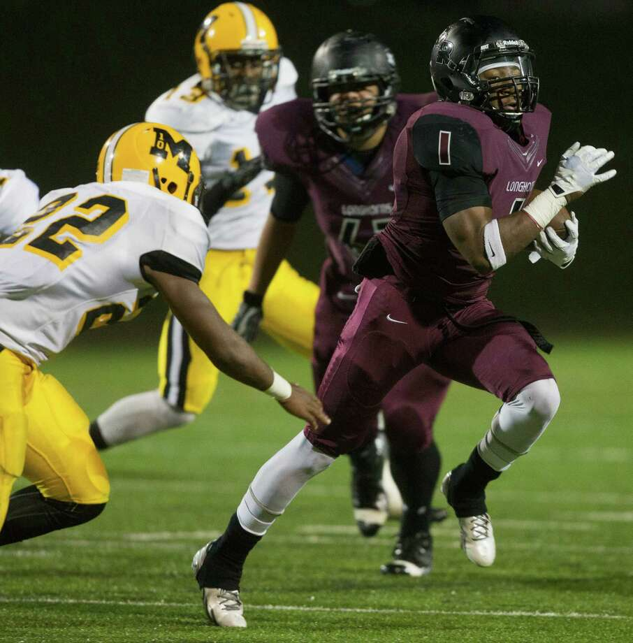 George Ranch running back Darius Anderson (1) rushes with the ball as Marshall's Dominick Dykes (22) attempts to make a tackle on the play during a high school playoff football game between Fort Bend Marshall and George Ranch, Friday, November 22, 2013 in Sugar Land. (Bob Levey/Special To Chronicle) Photo: Bob Levey, Houston Chronicle / ©2013 Bob Levey