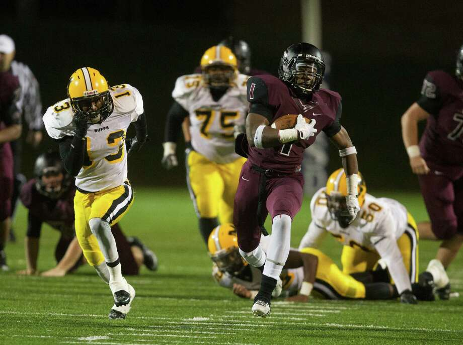 George Ranch running back Darius Anderson (1) breaks loose on a big gain early in the third quarter as Marshall's Jeremy Smith(13) pursues on the play during a high school playoff football game between Fort Bend Marshall and George Ranch, Friday, November 22, 2013 in Sugar Land. (Bob Levey/Special To Chronicle) Photo: Bob Levey, Houston Chronicle / ©2013 Bob Levey