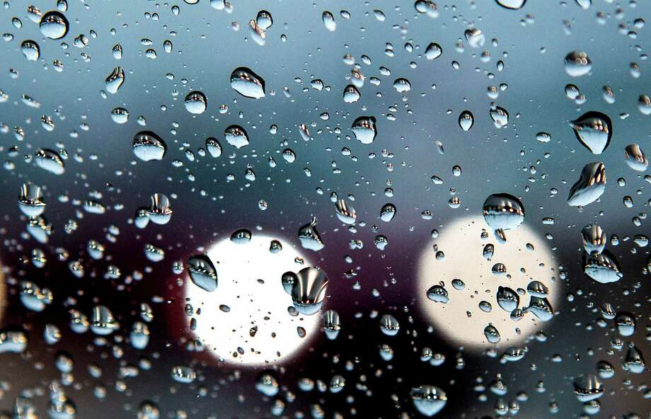 Cars are are shown in raindrops as they drive south on the I-45 service road Friday, Nov. 22, 2013, in The Woodlands. Photo: Brett Coomer, Houston Chronicle / © 2013 Houston Chronicle