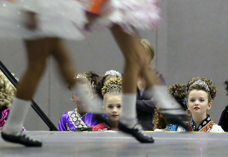 Young dancers watch and wait for their turn to perform in the Western U.S. Regional Oireachtas competition in Sacramento, Calif., Friday, Nov. 22, 2013. Hundreds of dancers of various ages from across the western U.S. compete in the three-day Irish dance competition, which is a qualifying event for both the North American Championships and the World Championships. (AP Photo/Rich Pedroncelli) Photo: Rich Pedroncelli, Associated Press