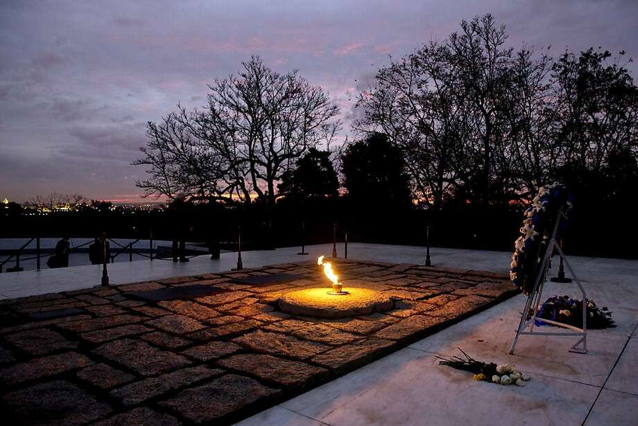 The eternal flame flickers in the early morning light at the grave of John F. Kennedy at Arlington National Cemetery on Friday, Nov. 22, 2013, on the 50th anniversary of Kennedy's death. (AP Photo/Jacquelyn Martin) Photo: Jacquelyn Martin, Associated Press