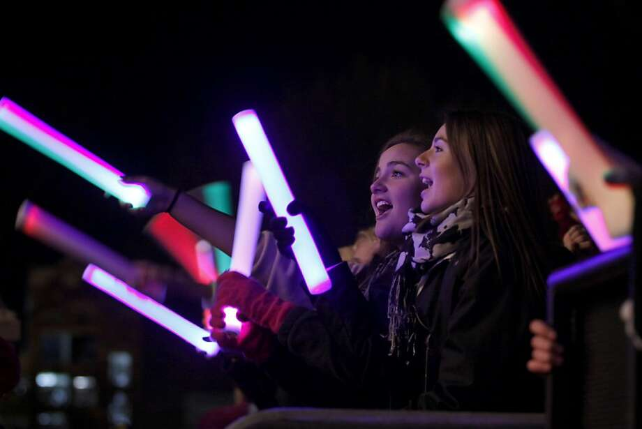 Fans watch a concert on the steps of the state Capitol, Friday, Nov. 22, 2013, in Lansing, Mich. The event was part of the 29th annual Silver Bells in the City celebration. (AP Photo/Al Goldis) Photo: Al Goldis, Associated Press