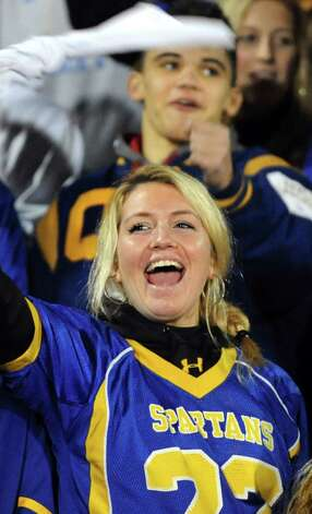 Queensbury fan Jill Davis, 18, cheers from the student section during their Class A state semifinal football game against Cornwall on Friday, Nov. 22, 2013, at Dietz Stadium in Kingston, N.Y. (Cindy Schultz / Times Union) Photo: Cindy Schultz / 00024745A