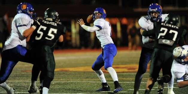 Queensbury's quarterback Aidan Switzer, center, gets ready to throw a pass during their Class A state semifinal football game against Cornwall on Friday, Nov. 22, 2013, at Dietz Stadium in Kingston, N.Y. (Cindy Schultz / Times Union) Photo: Cindy Schultz / 00024745A