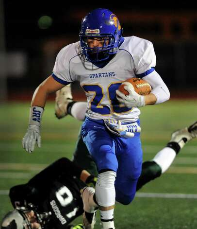 Queensbury's Kody Bruno carries the ball during their Class A state semifinal football game against Cornwall on Friday, Nov. 22, 2013, at Dietz Stadium in Kingston, N.Y. (Cindy Schultz / Times Union) Photo: Cindy Schultz / 00024745A